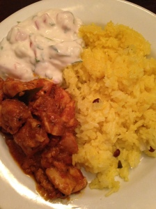 Chicken curry with lemon rice and yogurt salad.